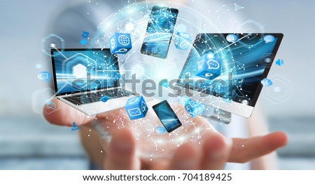Tech devices connected to each other by businessman on blurred background 3D rendering #704189425