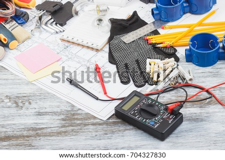 Different construction tools on the wooden background #704327830