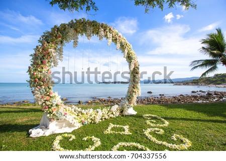 Forged wedding arch. Wedding on the sea #704337556