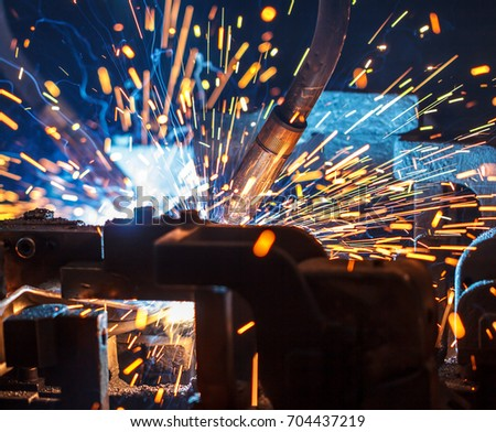 Welding robots movement in a car factory, automotive parts industry #704437219