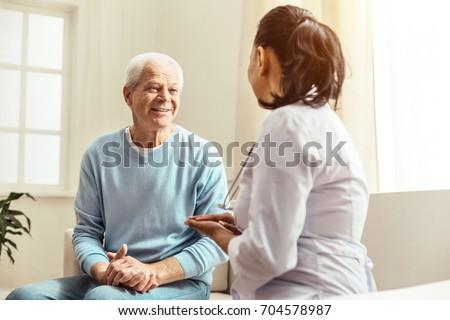 Pleasant cheerful man having a conversation #704578987