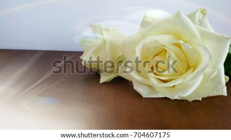 White roses on a wooden table. #704607175