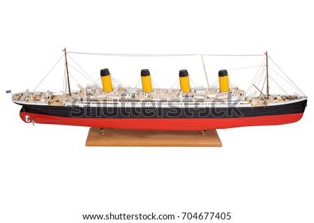 Handmade model of Titanic Beautiful Handmade model of Titanic isolated on white background. Royalty-Free Stock Photo #704677405