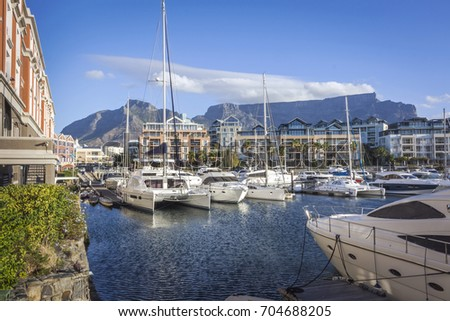 Famous V&A waterfront of Cape Town, SOUTH AFRICA, with table mountain background on the sunny day Royalty-Free Stock Photo #704688205