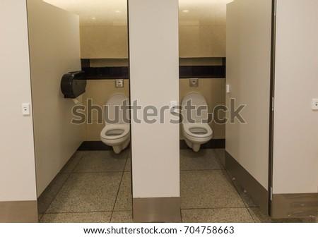 modern restroom interior public toilet urinals lined up #704758663