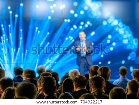 Audience listens to the lecturer at the conference hall Royalty-Free Stock Photo #704922217