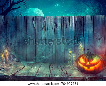 Halloween background. Spooky pumpkin on table. Halloween design with pumpkins and skull