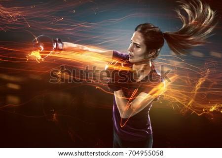 Woman practices self defense #704955058