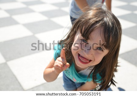Little girl making grimace #705053191