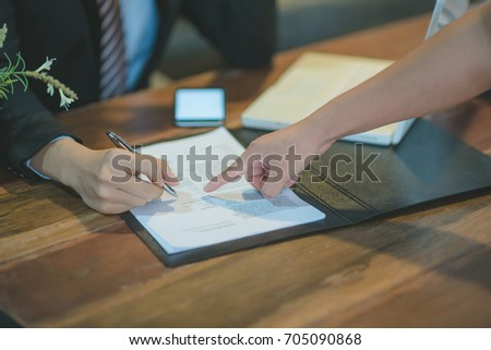 Cropped image of professional businesswoman working at her office via laptop, young female manager using portable computer device while sitting at modern loft, flare light, work process concept. #705090868