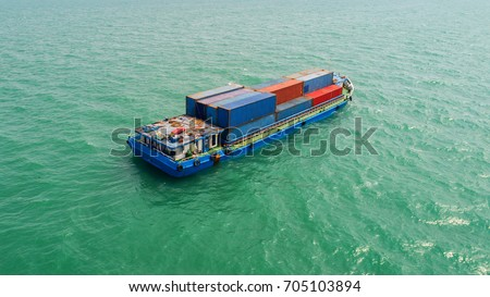 container,container ship in import export and business logistic,By crane,Trade Port , Shipping,cargo to harbor.Aerial view,Water transport,International,Shell Marine,transportation,logistic,trade,port #705103894