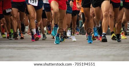 Marathon running race, people feet on city road Royalty-Free Stock Photo #705194551