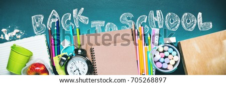 Concept Back To School Alarm Clock Color Chalk Pencil Apple Notebook Stationery on Black and Blackboard Background. Design Copy Space Supplies Top View Flat Lay Banner