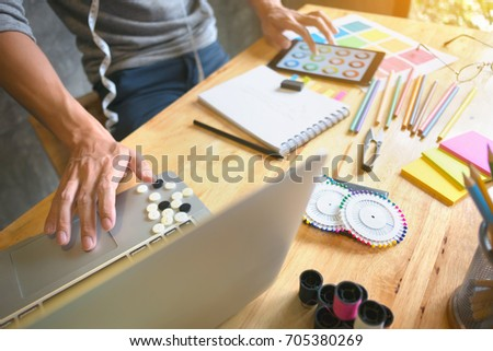 creative / fashion designer working on laptop and digital tablet at modern home studio #705380269