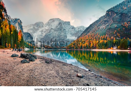 Popular photographers attraction of Braies Lake. Colorful autumn landscape in Italian Alps, Naturpark Fanes-Sennes-Prags, Dolomite, Italy, Europe. Beauty of nature concept background. Royalty-Free Stock Photo #705417145