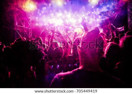 crowd with raised hands at concert - summer music festival #705449419