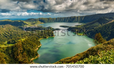 Establishing shot of the Lagoa das Sete Cidades lake taken from Vista do Rei in the island of Sao Miguel, The Azores, Portugal. The Azores are a hidden gem holiday destination in Europe.  #705450700