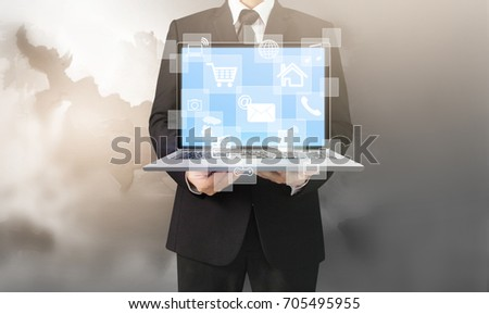 Handsome business man and suit holding laptop in hands  #705495955