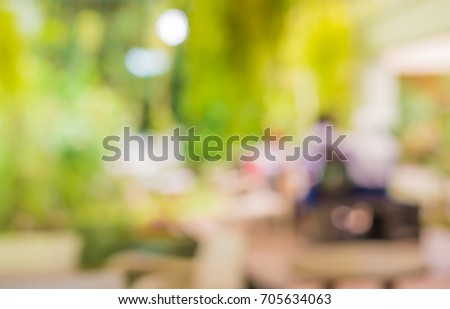 Abstract blur image of coffee shop or restaurant on day time with bokeh  for background usage. #705634063