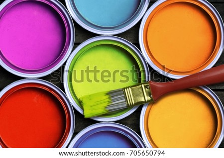 Seven colorful paint with a brush Royalty-Free Stock Photo #705650794