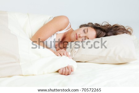 Pretty young woman sleeps in her bed #70572265