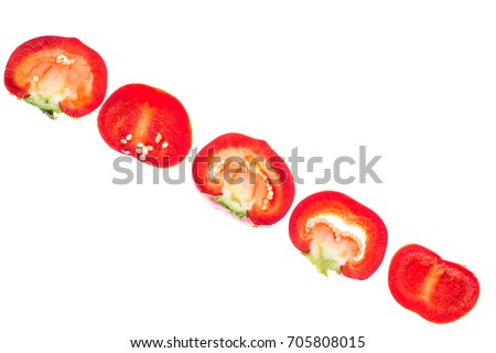 Red sweet chopped round pepper, isolated on white background. Studio Photo #705808015