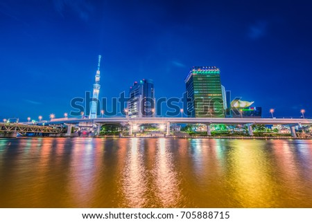 TOKYO - AUG 21: View of Sumida River with Tokyo Skytree and The Asahi Beer building in Tokyo on AUG 21. 2017 in Japan. Asakusa is a landmark of old town popular tourist spot. #705888715