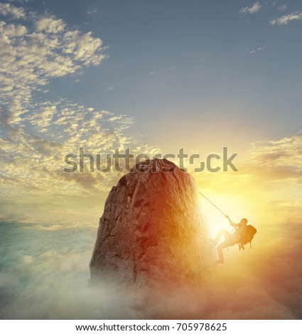 Businessman climb a mountain to get the flag. Achievement business goal and difficult career concept Royalty-Free Stock Photo #705978625