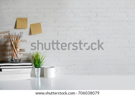 Mock up Marble table with Books, Craft tools, pencils and houseplant. desk workspace with copy space for products display montage. #706038079