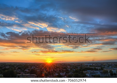 Sunset over evening city, sky with clouds. #706052974