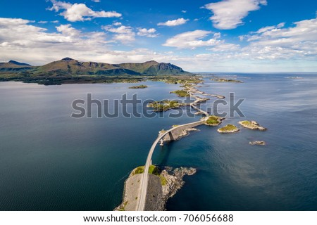 "Atlantic Ocean Road or the Atlantic Road (Atlanterhavsveien) been awarded the title as ""Norwegian Construction of the Century"". The road classified as a National Tourist Route. Aerial photography Royalty-Free Stock Photo #706056688"