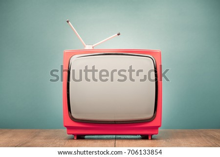 Retro old TV receiver on the table front gradient mint green background. Vintage style filtered photo