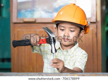 Children use a hammer to nail. #706178899