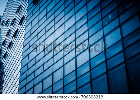 closeup of glass wall of modern building #706303219