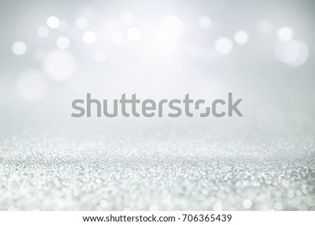 blue and silver glitter lights bokeh abstract background holiday. defocused. #706365439