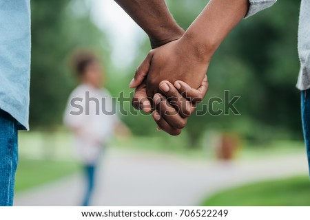 cropped shot of african american couple holding hands #706522249