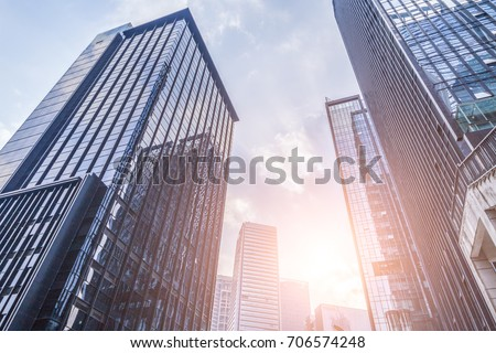 Common modern business skyscrapers, high-rise buildings, architecture raising to the sky, sun. Concepts of financial, economics,  #706574248