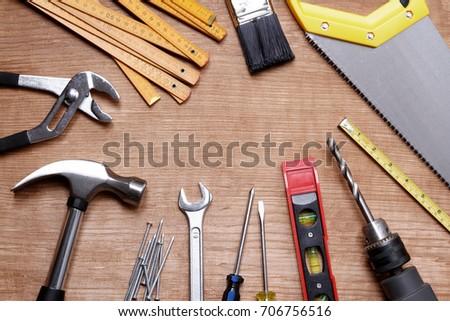 Assorted work tools on wood #706756516