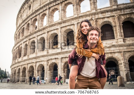 Young couple at the Colosseum, Rome - Happy tourists visiting italian famous landmarks Royalty-Free Stock Photo #706768765