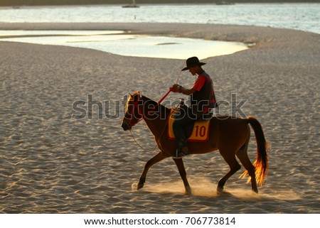 SONGKHLA THAILAND - August 31, 2017: Unknown cowboy show on the beach on August 31, 2017 in Songkhla, Thailand. #706773814