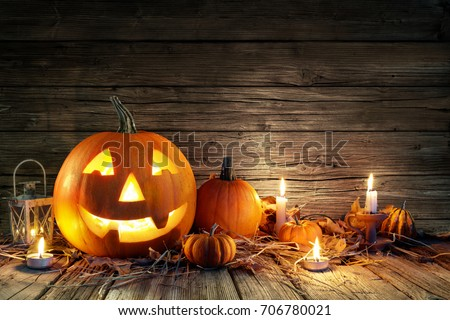 Halloween Pumpkins And Candles On Wooden Royalty-Free Stock Photo #706780021