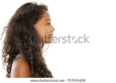 profile of a smiling, beautiful young dark-skinned woman #707045608