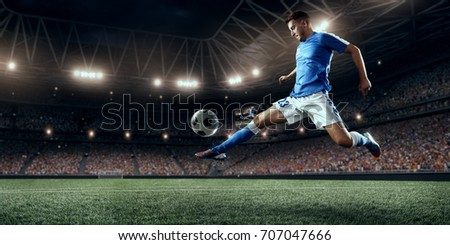 Soccer player performs an action play on a professional stadium #707047666