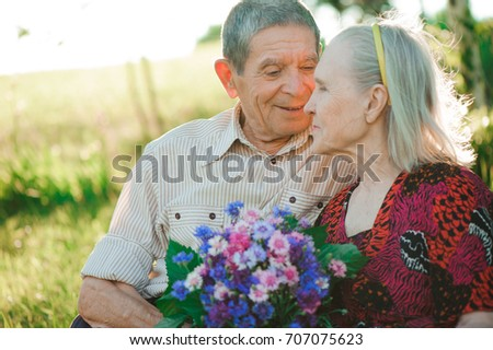 beautiful happy old people sitting in the  park #707075623