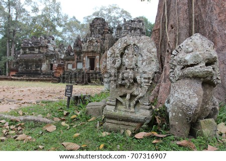 Sculpture on the ruins of a ruined temple in Angkor complex, near the ancient capital of Cambodia - Siem Reap #707316907