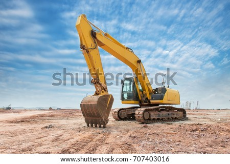 Heavy earth mover with blue sky in the background Royalty-Free Stock Photo #707403016
