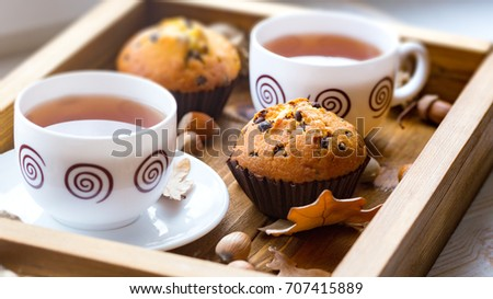 breakfast - cake and cup of tea on a wooden tray Royalty-Free Stock Photo #707415889