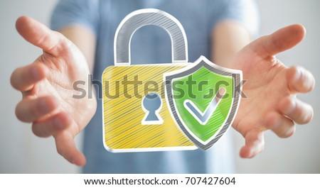 Businessman on blurred background holding a hand-drawn antivirus system #707427604