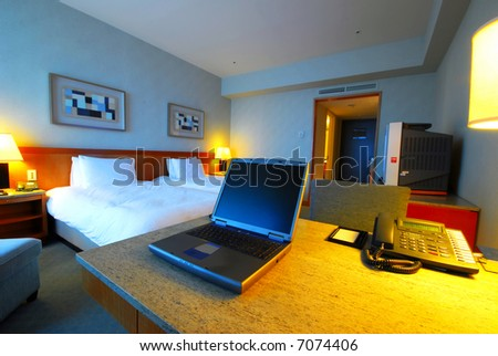 Interior of a modern hotel room with laptop computer #7074406