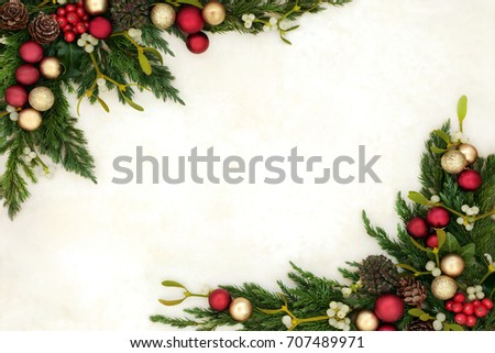 Christmas background border with gold and red bauble decorations, holly, mistletoe, ivy, juniper fir and pine cones on old parchment paper.